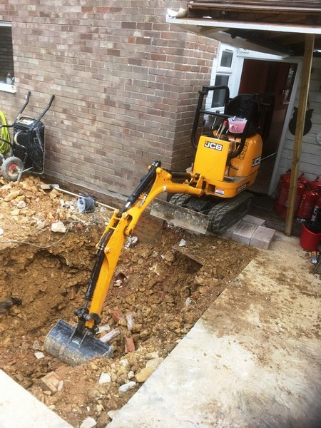 Exposing a drain for a new manhole