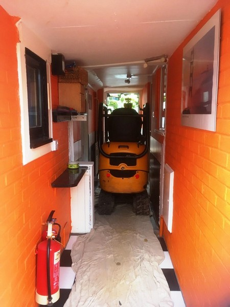 The JCB can even fit through the house